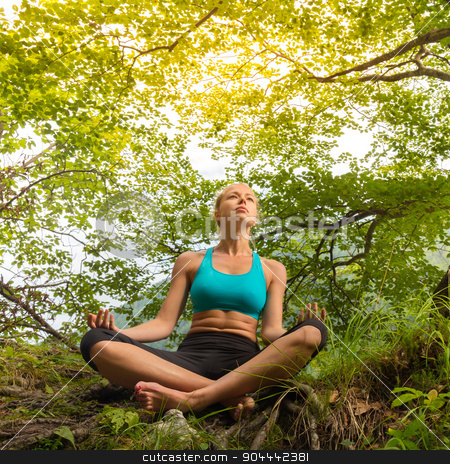 Woman relaxing in beautiful nature. stock photo, Relaxed woman enjoying freedom and life in beautiful natural environment. Blissful girl in lotus pose feeling relaxed, free and happy. Concept of freedom, happiness, enjoyment and natural balance. by kasto