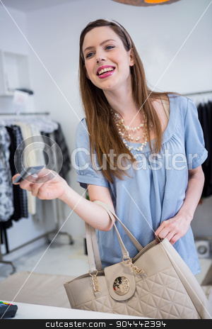 Brunette paying at till with credit card stock photo, Brunette paying at till with credit card in fashion boutique by Wavebreak Media