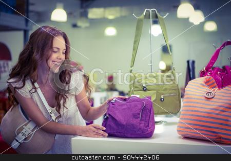 Pretty woman shopping for bags stock photo, Pretty woman shopping for bags at the shopping mall by Wavebreak Media