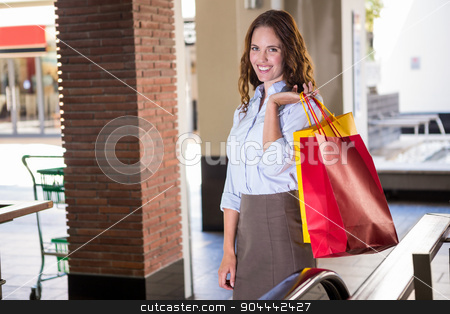 Pretty woman on the escalator stock photo, Pretty woman on the escalator at the shopping mall by Wavebreak Media