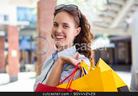 Pretty woman shopping at the mall stock photo, Pretty woman shopping at the mall on a sunny day by Wavebreak Media