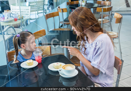 Mother and daughter arguing at table stock photo, Mother and daughter arguing at table in coffee shop by Wavebreak Media