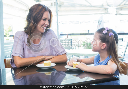 Mother and daughter enjoying cakes stock photo, Mother and daughter enjoying cakes at cafe terrace on a sunny day by Wavebreak Media