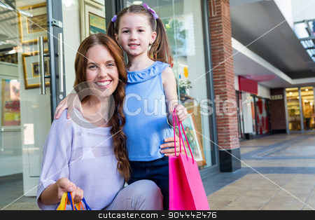 Mother and daughter shopping at the mall  stock photo, Mother and daughter shopping at the mall  on a sunny day by Wavebreak Media