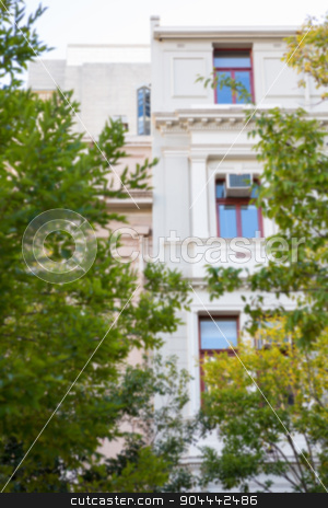 Large building with trees stock photo, Large building with trees in the city by Wavebreak Media