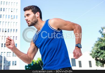 Handsome athlete jogging stock photo, Handsome athlete jogging in the city by Wavebreak Media
