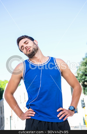 Handsome athletic stretching his neck stock photo, Handsome athletic stretching his neck in the city by Wavebreak Media