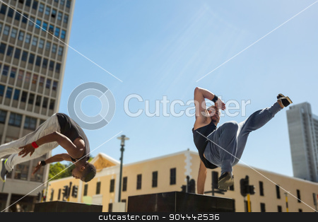 Happy friends doing parkour in the city stock photo, Happy friends doing parkour in the city on a sunny day by Wavebreak Media