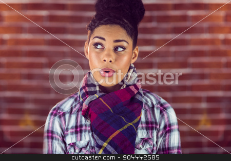 A beautiful happy hipster whistling stock photo, A beautiful happy hipster whistling against a red brick wall by Wavebreak Media