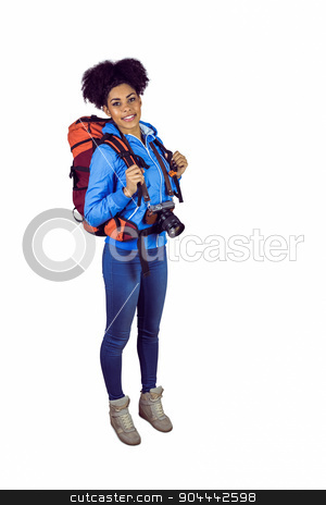 Portrait of a young woman with camera and backpack stock photo, Portrait of a young woman with camera and backpack against a white background by Wavebreak Media