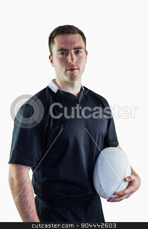 Rugby player holding a rugby ball stock photo, Portrait of a rugby player holding a rugby ball by Wavebreak Media