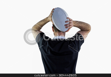 Rugby player about to throw a rugby ball stock photo, Back view of a rugby player about to throw a rugby ball by Wavebreak Media