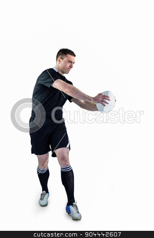 Rugby player doing a side pass stock photo, Rugby player doing a side pass on a white background by Wavebreak Media