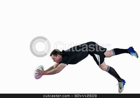 A rugby player scoring a try stock photo, A determined rugby player scoring a try by Wavebreak Media