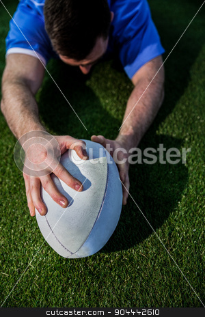 A rugby player scoring a try stock photo, Upward view of a rugby player scoring a try by Wavebreak Media