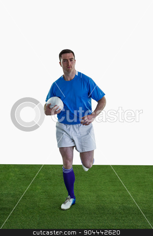 Rugby player running with the rugby ball stock photo, Portrait of a rugby player running with the rugby ball by Wavebreak Media