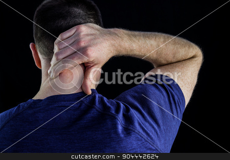 Rear view of a man with neck pain over stock photo, Rear view of a man with neck pain over over black background by Wavebreak Media