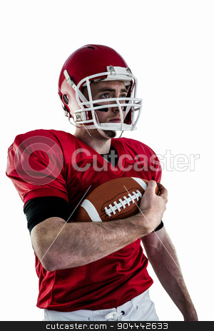 American football player being ready for playing stock photo, American football player being ready for playing against white background by Wavebreak Media