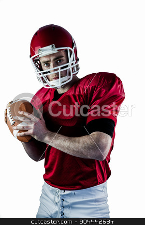 Portrait of american football player being about to throw footba stock photo, Portrait of american football player being about to throw football against white background by Wavebreak Media