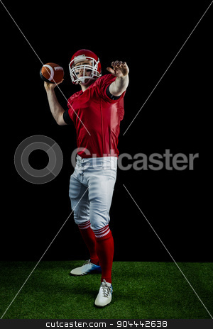 American football player throwing football stock photo, American football player throwing football on american football field by Wavebreak Media