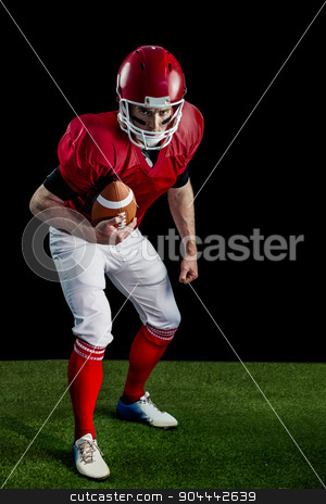Portrait of focused american football player being ready to atta stock photo, Portrait of focused american football player being ready to attack on american football field by Wavebreak Media