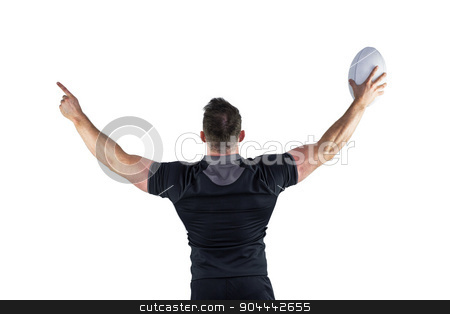 Rugby player celebrating with the ball stock photo, Rugby player celebrating with the ball on white background by Wavebreak Media