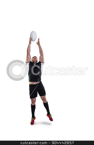 Rugby player catching the ball stock photo, Rugby player catching the ball on white background by Wavebreak Media