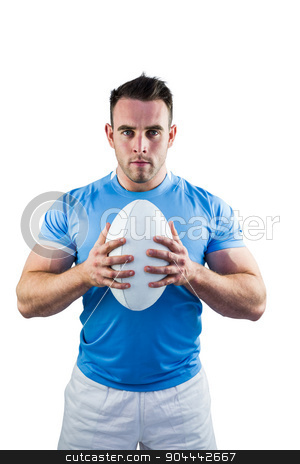 Rugby player looking at camera with ball stock photo, Rugby player looking at camera with ball on white background by Wavebreak Media