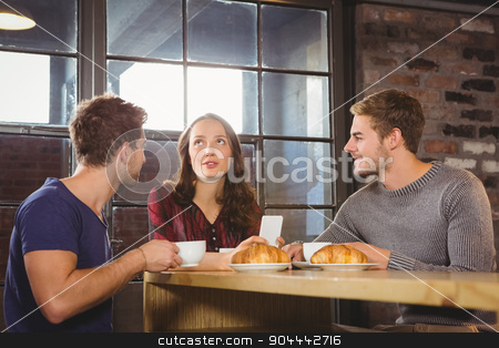 Friends talking and enjoying coffee and croissants  stock photo, Friends talking and enjoying coffee and croissants at coffee shop by Wavebreak Media