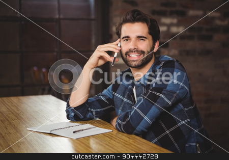 Young man on the phone stock photo, Young man on the phone in a cafe by Wavebreak Media