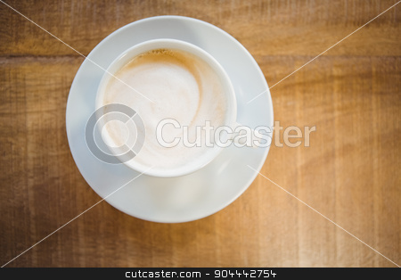 Close up of cup of coffee stock photo, Close up of cup of coffee on table by Wavebreak Media