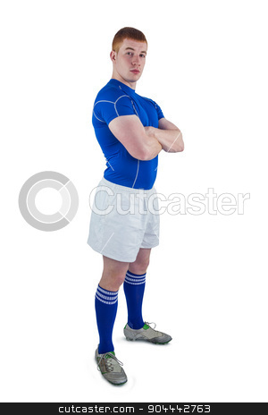Portrait of a rugby player with arms crossed stock photo, Portrait of a rugby player with arms crossed on a white background by Wavebreak Media