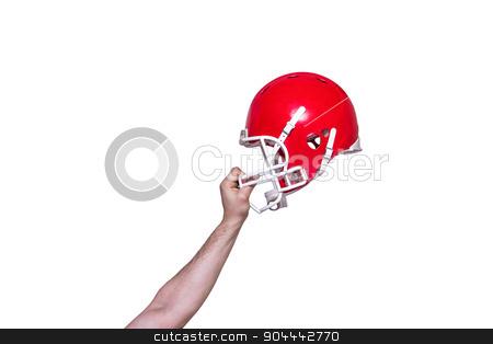 American football player handing his helmet stock photo, American football player handing his helmet on a white background  by Wavebreak Media