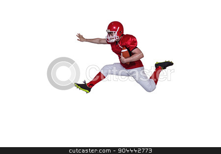 American football player jumping with the ball stock photo, American football player jumping with the ball on a white background by Wavebreak Media