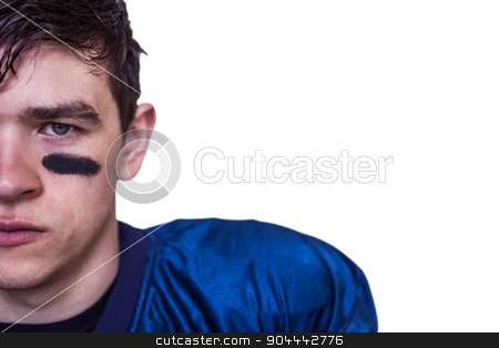 American football player looking at the camera stock photo, Portrait of a stern american football player on white background by Wavebreak Media