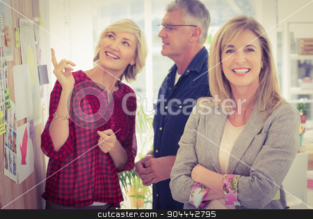 Businesswoman with arms crossed with her team behind stock photo, Businesswoman with arms crossed with her team behind at office by Wavebreak Media