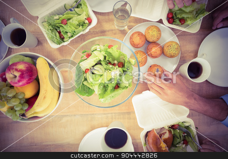 Business people having lunch together stock photo, Business people having lunch together in the office by Wavebreak Media