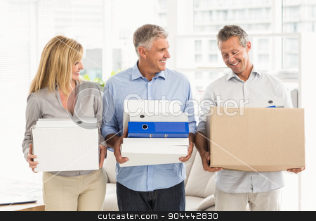 Casual business people talking and carrying cartons stock photo, Casual business people talking and carrying cartons in the office by Wavebreak Media