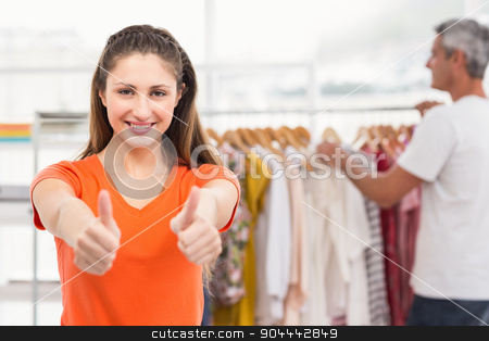 Casual businesswoman volunteering and doing thumbs up stock photo, Portrait of casual businesswoman volunteering and doing thumbs up in the office by Wavebreak Media