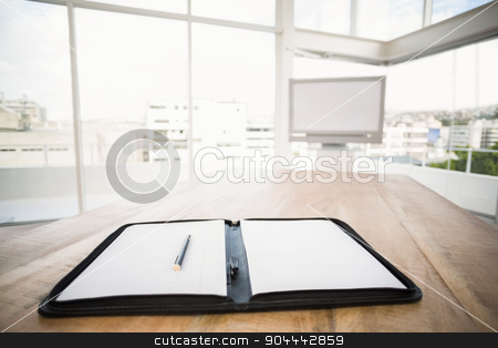 Planner in front of meeting room stock photo, Planner in front of meeting room in the office by Wavebreak Media