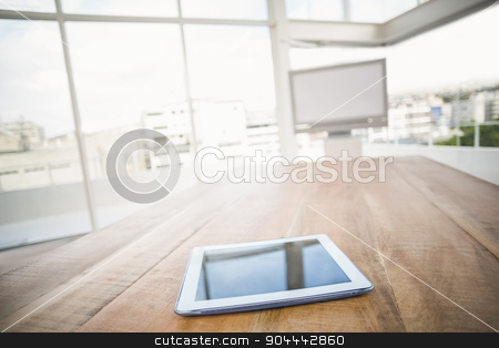 Tablet in front of meeting room stock photo, Tablet in front of meeting room in the office by Wavebreak Media
