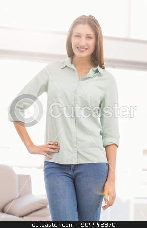 Smiling casual businesswoman posing stock photo, Portrait of smiling casual businesswoman posing in the office by Wavebreak Media