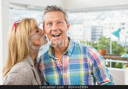Casual designer giving her colleague kiss on cheek stock photo, Portrait of casual designer giving her colleague kiss on cheek in the office by Wavebreak Media