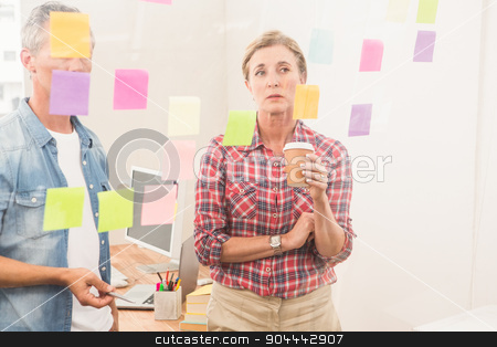 Casual business colleagues working with sticky notes stock photo, Casual business colleagues working with sticky notes in the office by Wavebreak Media