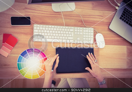 Designer working with digitizer stock photo, Designer working with digitizer in the office by Wavebreak Media