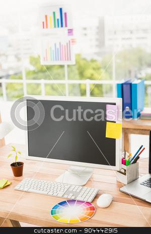 Creative working desk stock photo, Creative working desk in the office by Wavebreak Media