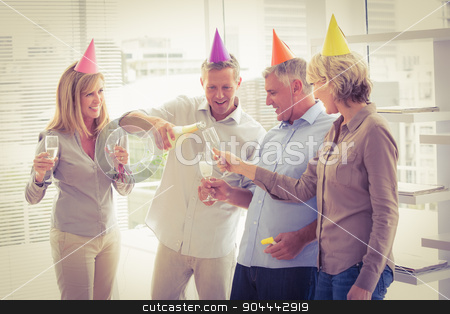Casual business people toasting and celebrating birthday stock photo, Casual business people toasting and celebrating birthday in the office by Wavebreak Media