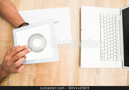 Hands using blank screen tablet stock photo, Hands using blank screen tablet on wooden desk by Wavebreak Media
