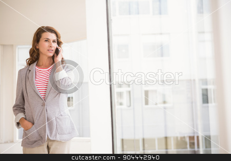 Casual businesswoman having a phone call stock photo, Casual businesswoman having a phone call in the office by Wavebreak Media