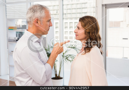 Casual businessman being upset about his colleague stock photo, Casual businessman being upset about his colleague in the office by Wavebreak Media